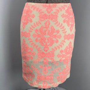Bright coral and off white skirt
